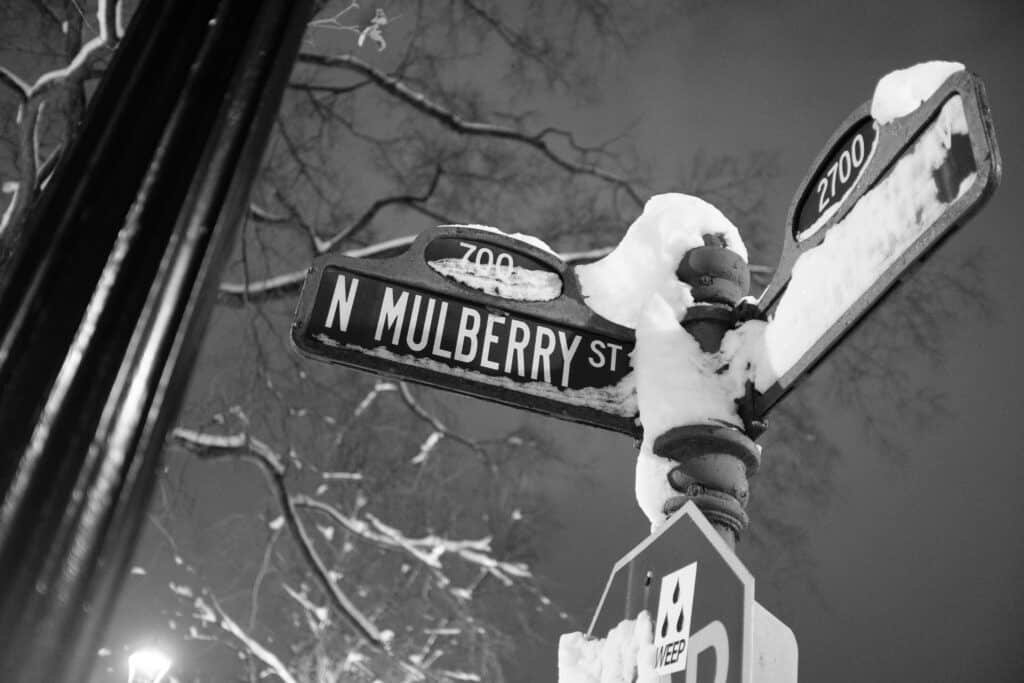 Monument Ave Street Sign Covered In Snow